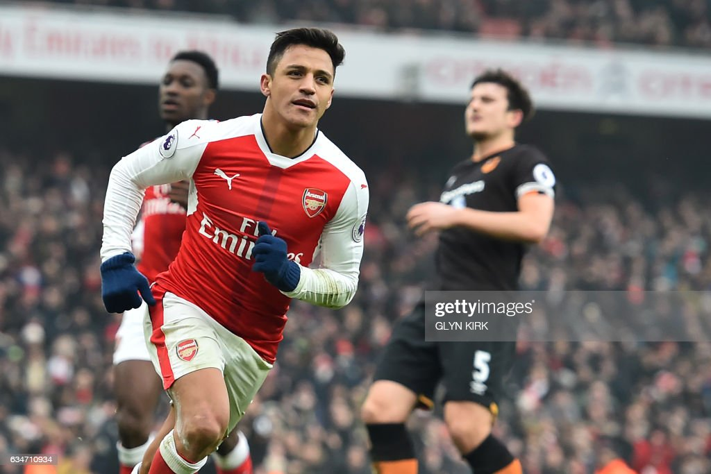 Arsenal's Chilean striker Alexis Sanchez celebrates after scoring their second goal from the penalty spot during the English Premier League football match between Arsenal and Hull City at the Emirates Stadium in London on February 11, 2017. Arsenal won the game 2-0. / AFP / Glyn KIRK / RESTRICTED TO EDITORIAL USE. No use with unauthorized audio, video, data, fixture lists, club/league logos or 'live' services. Online in-match use limited to 75 images, no video emulation. No use in betting, games or single club/league/player publications. /