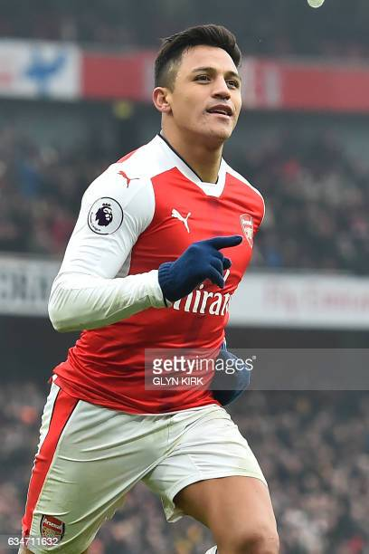 Arsenal's Chilean striker Alexis Sanchez celebrates after scoring their second goal from the penalty spot during the English Premier League football...