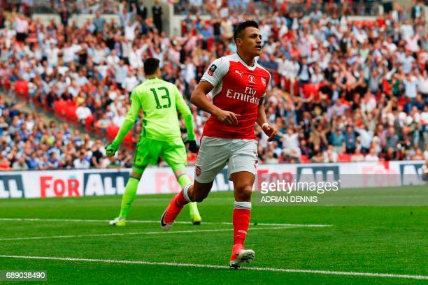 Arsenal's Chilean striker Alexis Sanchez celebrates after scoring the opening goal of the English FA Cup final football match between Arsenal and...