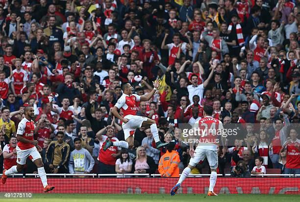 Arsenal's Chilean striker Alexis Sanchez celebrates scoring his goal with team mates Arsenal's German midfielder Arsenal's English midfielder Theo...