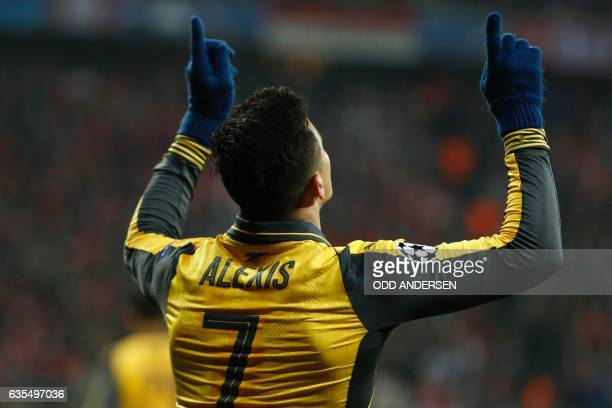 Arsenal's Chilean striker Alexis Sanchez celebrates scoring the 11 goal during the UEFA Champions League round of sixteen football match between FC...