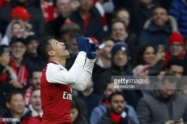 Arsenal's Chilean striker Alexis Sanchez celebrates scoring the team's second goal during the English Premier League football match between Arsenal...