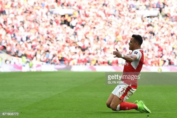 Arsenal's Chilean striker Alexis Sanchez celebrates scoring their second goal during the FA Cup semifinal football match between Arsenal and...