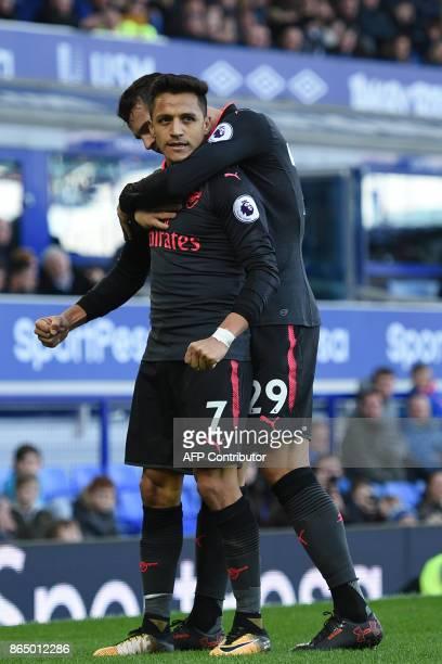 Arsenal's Chilean striker Alexis Sanchez celebrates scoring their fifth goal with Arsenal's Swiss midfielder Granit Xhaka during the English Premier...