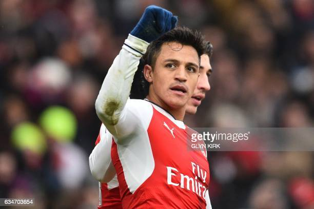 Arsenal's Chilean striker Alexis Sanchez celebrates with Arsenal's Spanish defender Hector Bellerin after scoring the opening goal of the English...