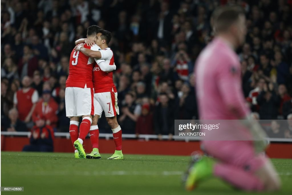 Arsenal's Chilean striker Alexis Sanchez (2nd L) celebrates with Arsenal's Spanish striker Lucas Perez (L) after scoring their fourth goal during the English FA cup quarter final football match between Arsenal and Lincoln City at The Emirates Stadium in London on March 11, 2017. / AFP PHOTO / Ian KINGTON / RESTRICTED TO EDITORIAL USE. No use with unauthorized audio, video, data, fixture lists, club/league logos or 'live' services. Online in-match use limited to 75 images, no video emulation. No use in betting, games or single club/league/player publications. /