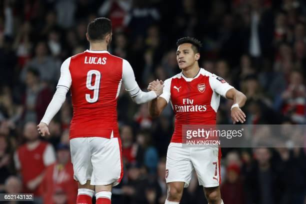 Arsenal's Chilean striker Alexis Sanchez celebrates with Arsenal's Spanish striker Lucas Perez after scoring their fourth goal during the English FA...