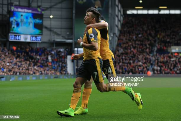 Arsenal's Chilean striker Alexis Sanchez celebrates with Arsenal's Spanish defender Hector Bellerin after scoring during the English Premier League...