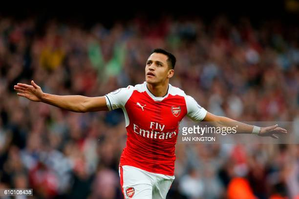 Arsenal's Chilean striker Alexis Sanchez celebrates scoring the opening goal during the English Premier League football match between Arsenal and...