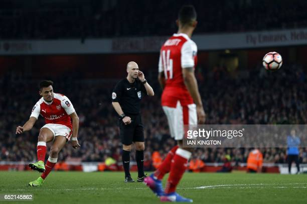 Arsenal's Chilean striker Alexis Sanchez hits the post with this freekick during the English FA cup quarter final football match between Arsenal and...
