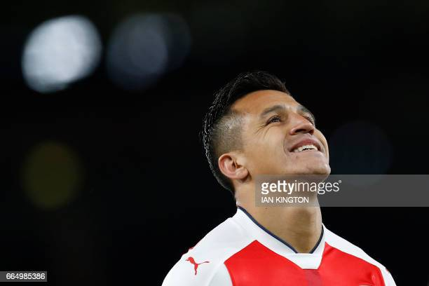 Arsenal's Chilean striker Alexis Sanchez reacts during the English Premier League football match between Arsenal and West Ham United at the Emirates...