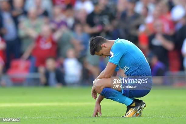 Arsenal's Chilean striker Alexis Sanchez reacts during the English Premier League football match between Liverpool and Arsenal at Anfield in...