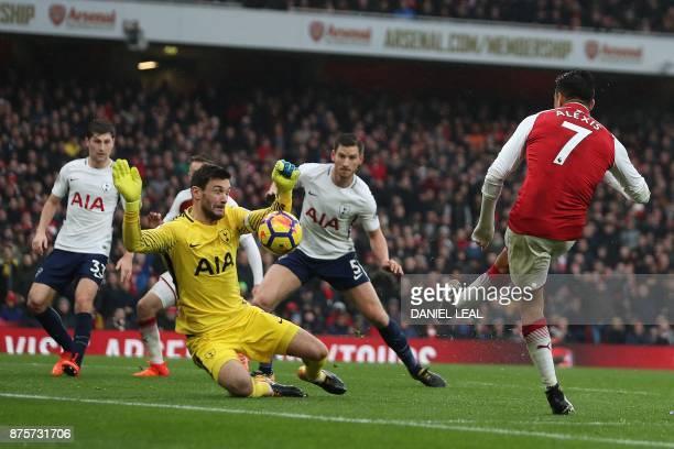 Arsenal's Chilean striker Alexis Sanchez shoots but fails to score past Tottenham Hotspur's French goalkeeper Hugo Lloris during the English Premier...