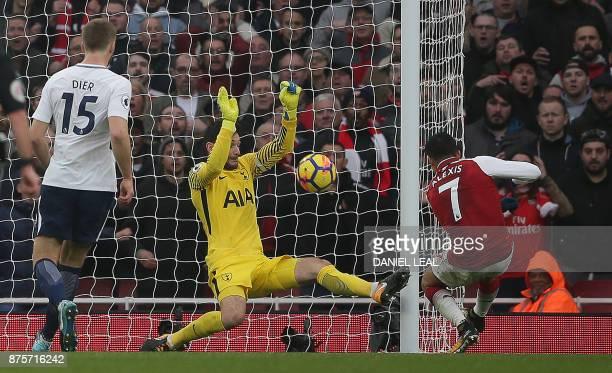 Arsenal's Chilean striker Alexis Sanchez shoots past Tottenham Hotspur's French goalkeeper Hugo Lloris to score his team's second goal during the...