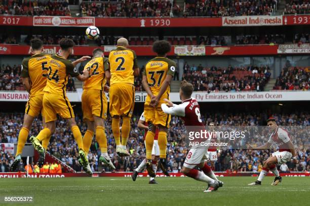 TOPSHOT Arsenal's Chilean striker Alexis Sanchez takes a free kick at goal during the English Premier League football match between Arsenal and...