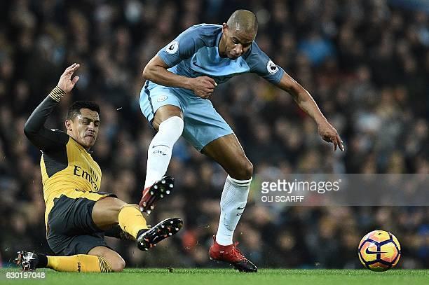 Arsenal's Chilean striker Alexis Sanchez vies with Manchester City's Brazilian midfielder Fernando during the English Premier League football match...
