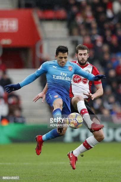 Arsenal's Chilean striker Alexis Sanchez vies with Southampton's English defender Jack Stephens during the English Premier League football match...