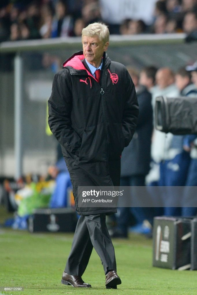 Arsenal's coach from France Arsene Wenger walks during the UEFA Europa League Group H football match between FC BATE Borisov and Arsenal FC in Borisov, outside Minsk, on September 28, 2017. /