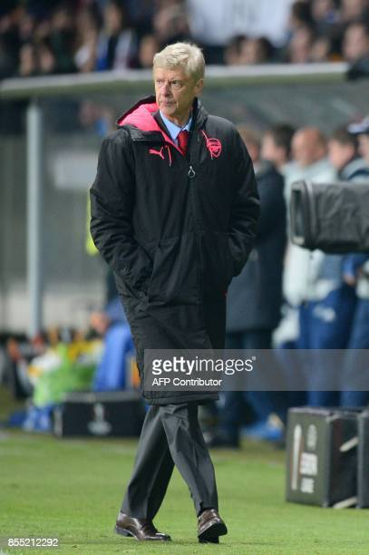 Arsenal's coach from France Arsene Wenger walks during the UEFA Europa League Group H football match between FC BATE Borisov and Arsenal FC in...