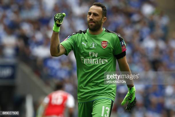 Arsenal's Colombian goalkeeper David Ospina celebrates Arsenal's first goal during the English FA Cup final football match between Arsenal and...