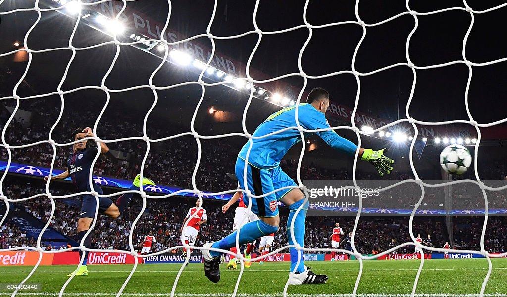Arsenal's Colombian goalkeeper David Ospina (C) tries to stop the shoot of Paris Saint-Germain's Uruguayan forward Edinson Cavani (L) during the UEFA Champions League Group A football match between Paris-Saint-Germain vs Arsenal FC, on September 13, 2016 at the Parc des Princes stadium in Paris.