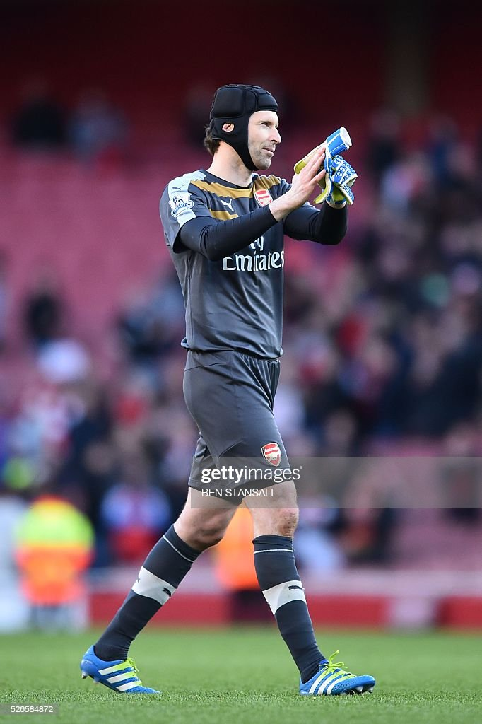 Arsenal's Czech goalkeeper Petr Cech applauds after the final whistle during the English Premier League football match between Arsenal and Norwich at the Emirates Stadium in London on April 30, 2016. / AFP / BEN STANSALL / RESTRICTED TO EDITORIAL USE. No use with unauthorized audio, video, data, fixture lists, club/league logos or 'live' services. Online in-match use limited to 75 images, no video emulation. No use in betting, games or single club/league/player publications. /