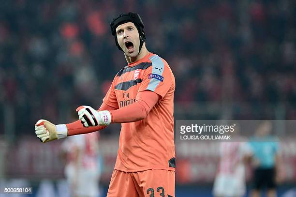 Arsenal's Czech goalkeeper Petr Cech celebrates after the UEFA Champions League Group F football match between Olympiacos and Arsenal at the Georgios...