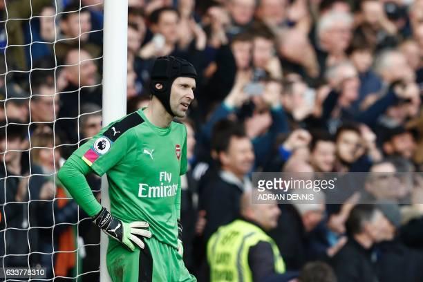 Arsenal's Czech goalkeeper Petr Cech reacts after Chelsea's Spanish midfielder Cesc Fabregas scored their third goal during the English Premier...