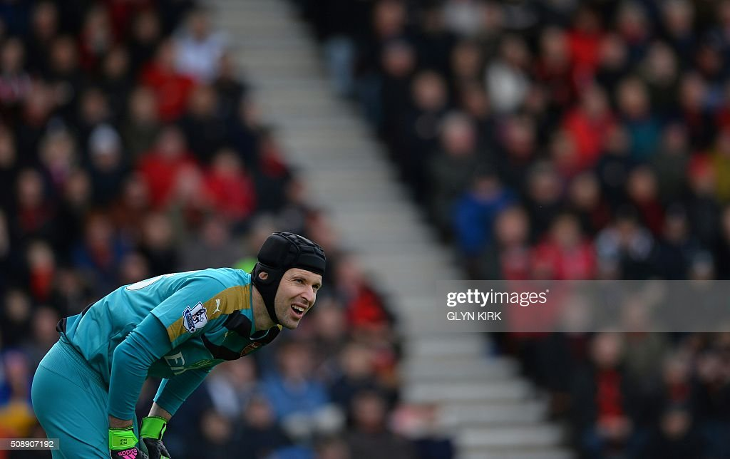 Arsenal's Czech goalkeeper Petr Cech reacts during the English Premier League football match between Bournemouth and Arsenal at the Vitality Stadium in Bournemouth, southern England on February 7, 2016. / AFP / GLYN KIRK / RESTRICTED TO EDITORIAL USE. No use with unauthorized audio, video, data, fixture lists, club/league logos or 'live' services. Online in-match use limited to 75 images, no video emulation. No use in betting, games or single club/league/player publications. /