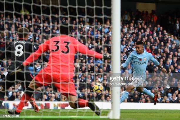 Arsenal's Czech goalkeeper Petr Cech saves this attempt from Manchester City's Brazilian striker Gabriel Jesus during the English Premier League...