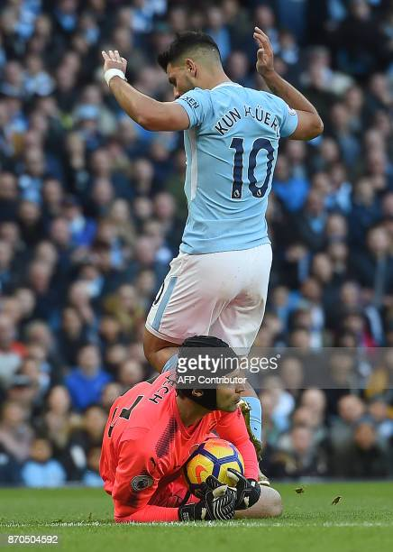 Arsenal's Czech goalkeeper Petr Cech saves with Manchester City's Argentinian striker Sergio Aguero during the English Premier League football match...