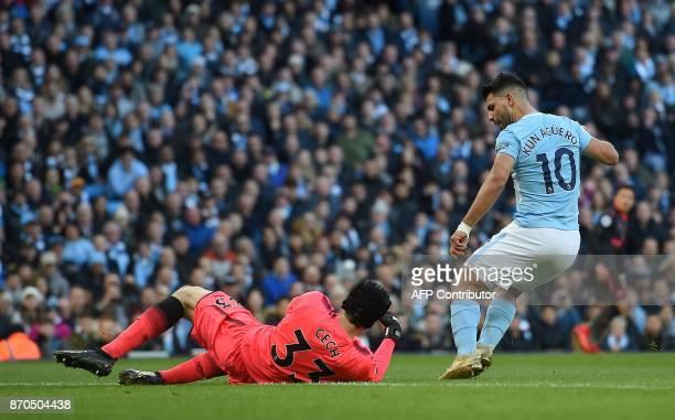 Arsenal's Czech goalkeeper Petr Cech ves with Manchester City's Argentinian striker Sergio Aguero during the English Premier League football match...