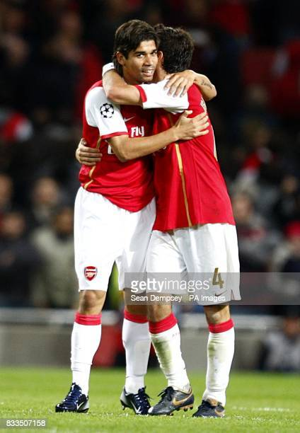 Arsenal's Da Silva Eduardo celebrates scoring their third goal wiht team mate Francesc Fabregas