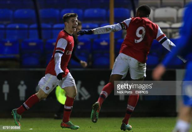 Arsenal's Daniel Crowley celebrates scoring against Peterborough United with Chuba Akpom