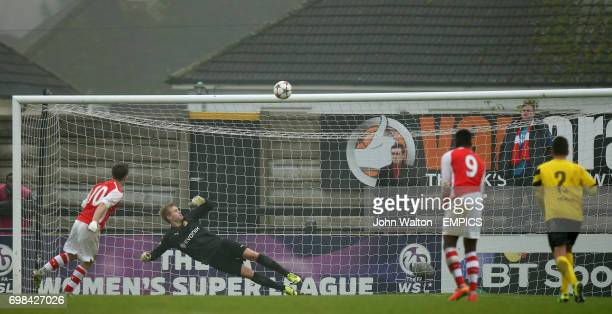 Arsenal's Daniel Crowley fires his penalty over the bar as Borussia Dortmund's goalkeeper Dominik Reimann looks on
