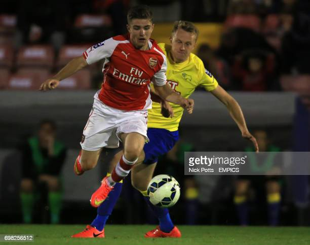 Arsenal's Daniel Crowley skips over challenge from Derby County's Jamie Hanson
