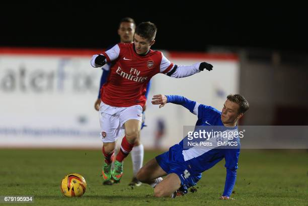 Arsenal's Daniel Crowley skips over tacklle from Peterborough United's Tom Conlon