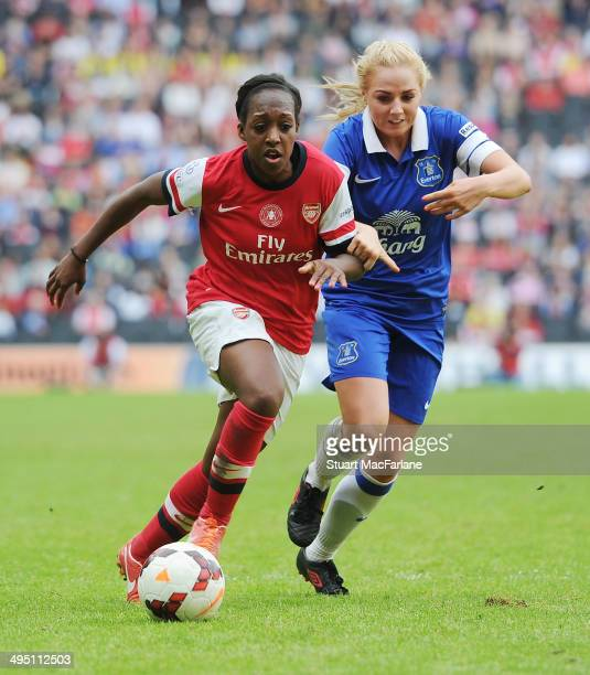 Arsenal's Danielle Carter breaks past Everton's Alex Greenwood during the match at Stadium mk on June 1 2014 in Milton Keynes England