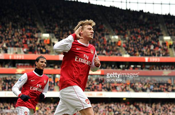 Arsenal's Danish striker Nicklas Bendtner celebrates scoring a goal during their FA Cup 4th round football match against Huddersfield Town at the...