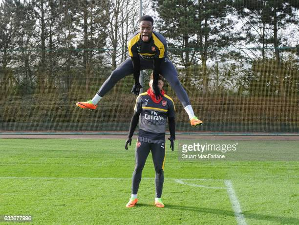 Arsenal's Danny Welbeck and Alex OxladeChamberlain joke around after a training session at London Colney on February 3 2017 in St Albans England