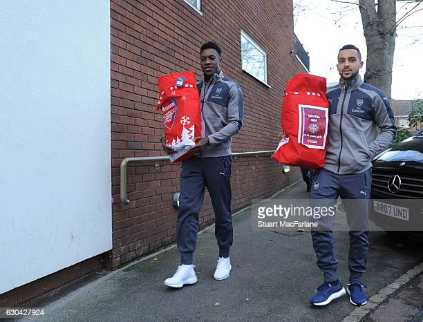 Arsenal's Danny Welbeck and Theo Walcott during a visit to charity Centre 404 on December 22 2016 in London England