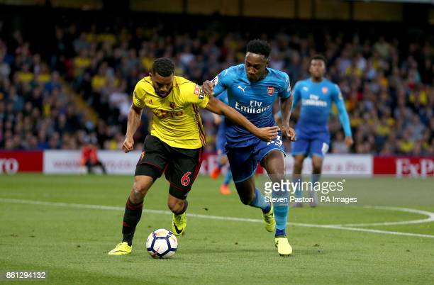Arsenal's Danny Welbeck and Watford's Adrian Mariappa during the Premier League match at Vicarage Road Watford