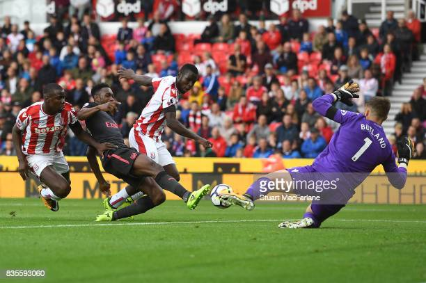Arsenal's Danny Welbeck has his shot saved by Stoke goalkeeper Jack Butland during the Premier League match between Stoke City and Arsenal at Bet365...