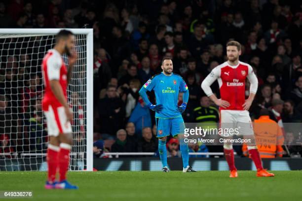 Arsenal's David Ospina looks dejected after his side concede another goal during the UEFA Champions League Round of 16 second leg match between...