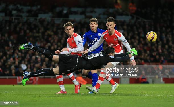 Arsenal's David Ospina punches the ball clear against Leicester City
