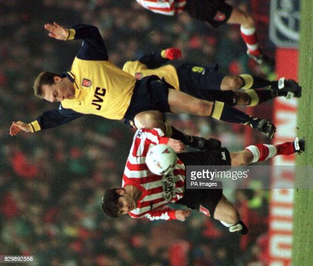Arsenal's David Platt goes in hard against Sunderland's Paul Bracewell at Roker Park today Photo by Owen Humphreys/PA
