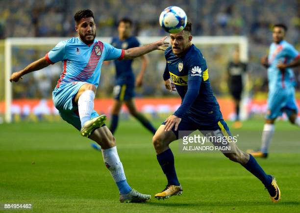 Arsenal's defender Federico Milo vies for the ball with Boca Juniors' midfielder Uruguayan Nahitan Nandez during their Argentina First Division...