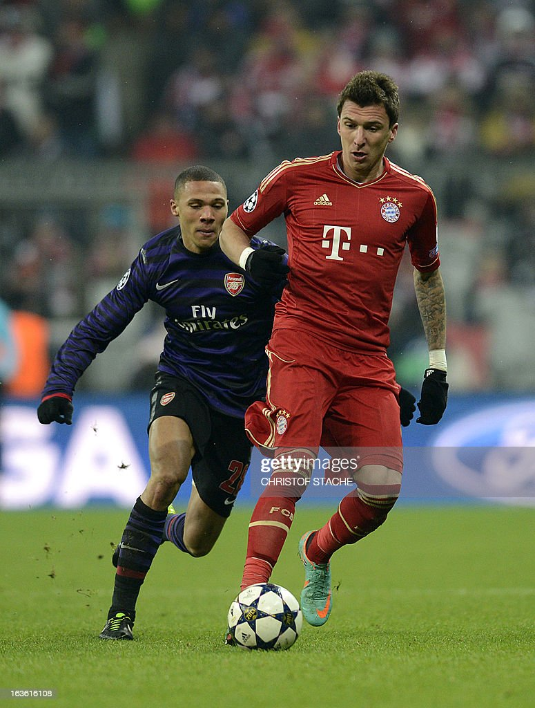 Arsenal´s defender Kieran Gibbs (L) and Bayern Munich's Croatian striker Mario Mandzukic vie for the ball during the UEFA Champions League round of 16 second leg football match between FC Arsenal London and FC Bayern Munich in the stadium in in Munich, southern Germany, on March 13, 2013. AFP PHOTO/CHRISTOF STACHE