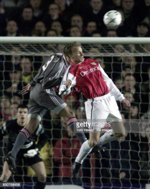 Arsenal's Dennis Bergkamp and Lyon's Edmilson during their Champions League match at Highbury Stadium THIS PICTURE CAN ONLY BE USED WITHIN THE...