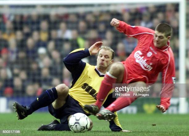 LEAGUE Arsenal's Dennis Bergkamp battles for the ball with Liverpool's Steven Gerrard during Premiership football match at Anfield Liverpool